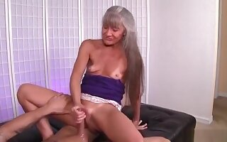 Leilani Gives Hand Job To Young Stud