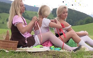 Karol Lilien and her babes enjoying a pussy chafing fest in the nature
