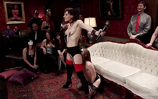 Alice March and Audrey Holiday are among a difficulty subs at a BDSM party