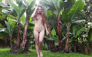 Lustful girl Irene is carrying-on with yummy pussy among the palms