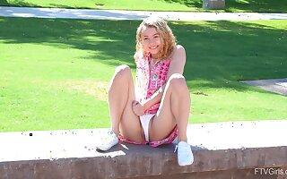 Blondie Allie loves pleasuring her pussy in outdoors. HD video